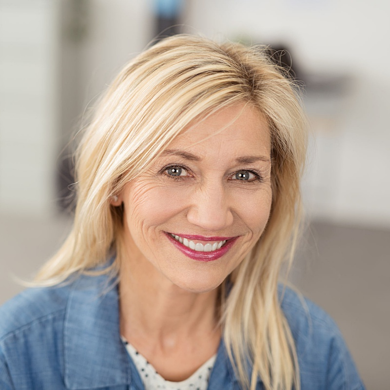 a blonde woman who received microneedling with prp